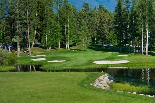 A view of a green protected by a collection of bunkers at Meadow Lake Golf Resort
