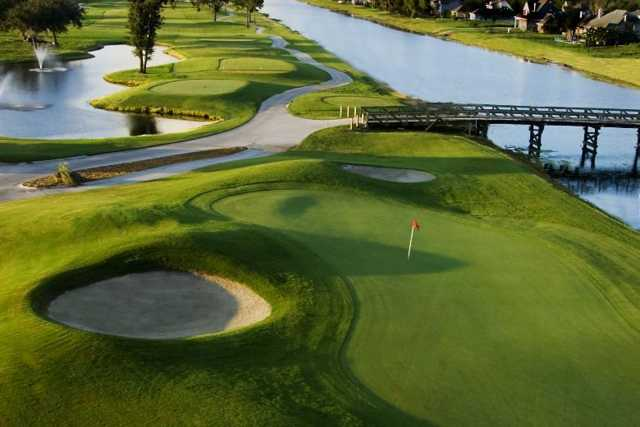 A view of the 9th green guarded by sand traps at Harvey 9 Course at Stonebridge Golf Club of New Orleans