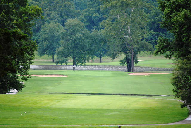 A view of a green flanked by bunkers at Piney Valley Golf Course