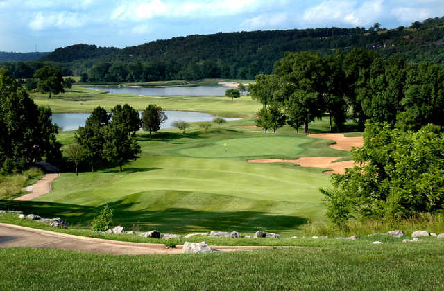 A view of a fairway and a green at Osage National Golf Club