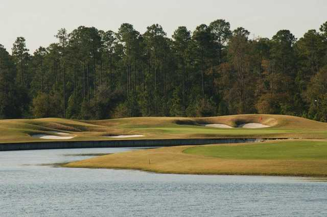 A view over the water of the 18th green at St. Johns Golf & Country Club