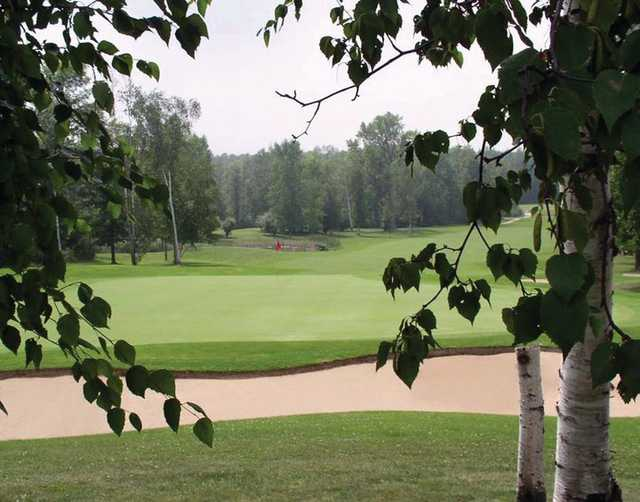 A view of a green protected by sand traps at Ubly Heights Golf Course