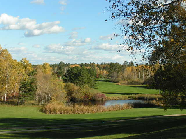 A view over a pond at A view of a green at Headwaters Golf Club