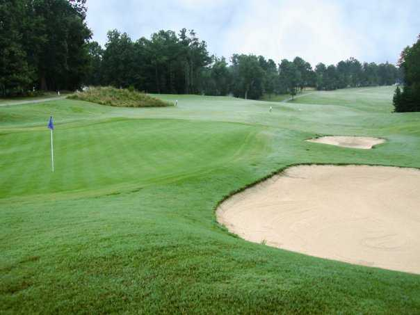 View of a green and bunkers at Riverwood Golf Club