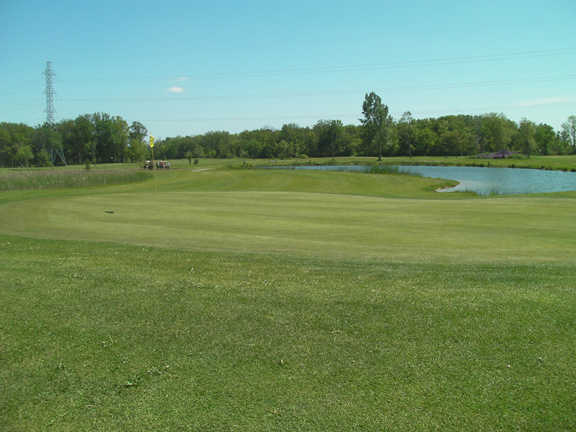 A view of a hole with water in background at Caistorville Golf Club