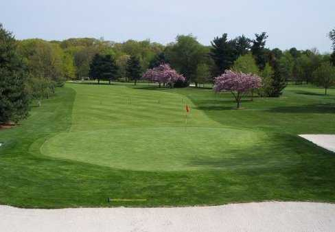 A spring view of a green guarded by bunkers at Pennsauken Country Club