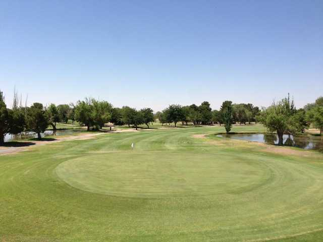 A view of a green with water coming into play at Dos Lagos Golf Club