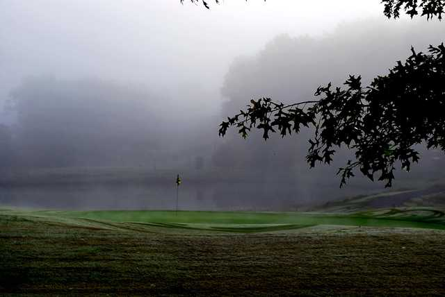 A view of a hole with water coming into play at Country Hills Golf Club