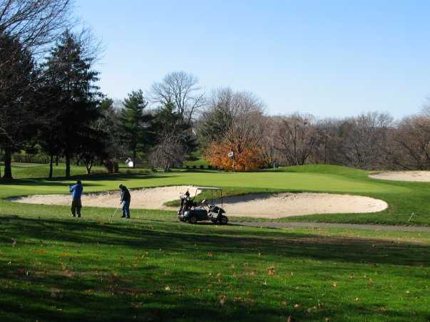 A view of a green protected by sand traps at Lancaster Host Golf Resort