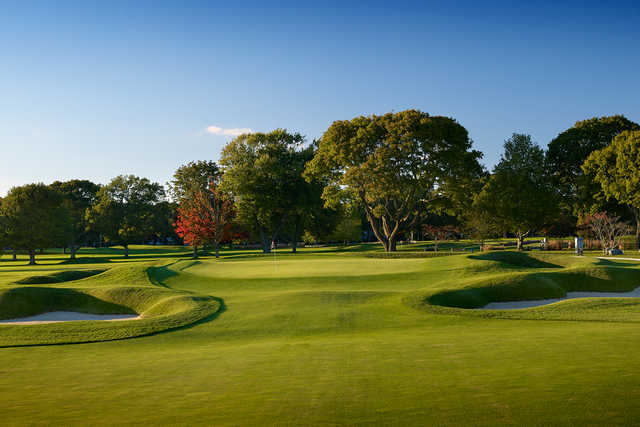A view of a green flanked by sand traps at Warwick Country Club