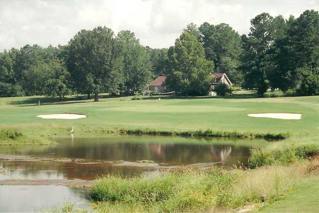 A view over a pond of the 17th hole at Ponderosa Country Club