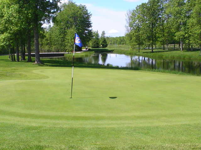 Water come into play on may holes at Smiths Falls Golf and Country Club. A view of the signature hole (16th green)