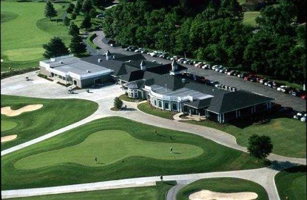 Aerial view of the clubhouse and the practice area at Hermitage Golf Course