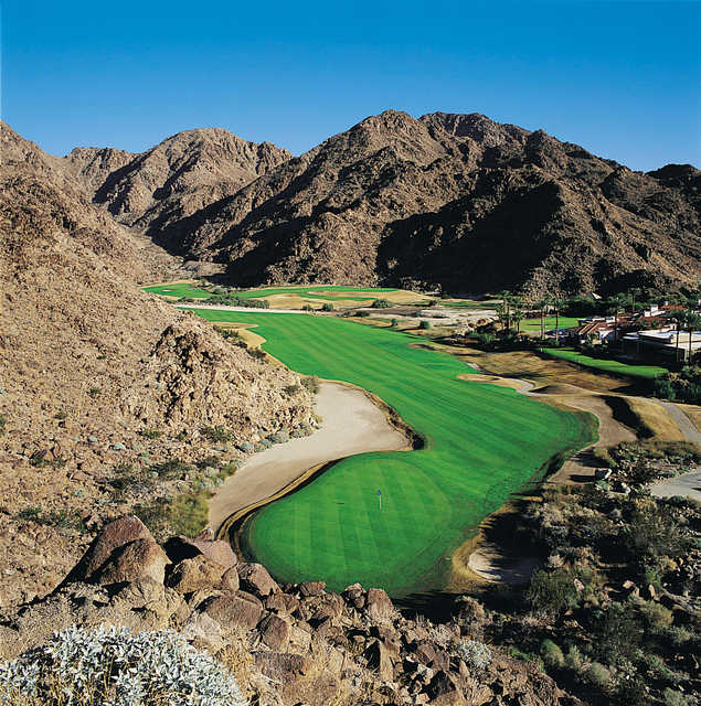 #15 on La Quinta's Mountain is laying along the base of the mountains - stay tight to the base and go for this par 5 in two. The green stays snug up against the base and will not be in full view.