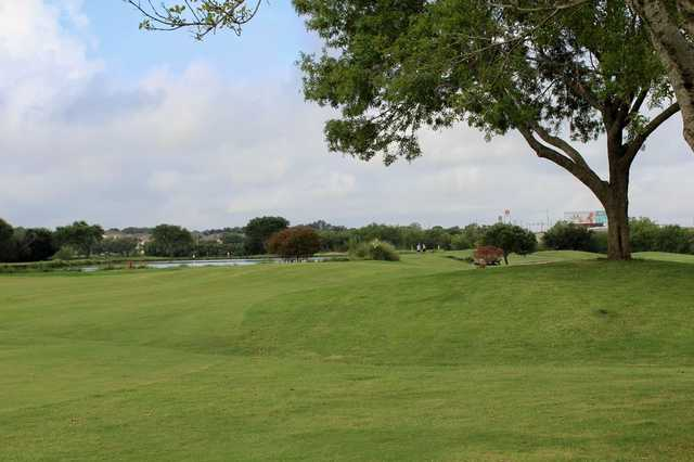 A view of a fairway with water on the left side at Northcliffe Golf & Country Club