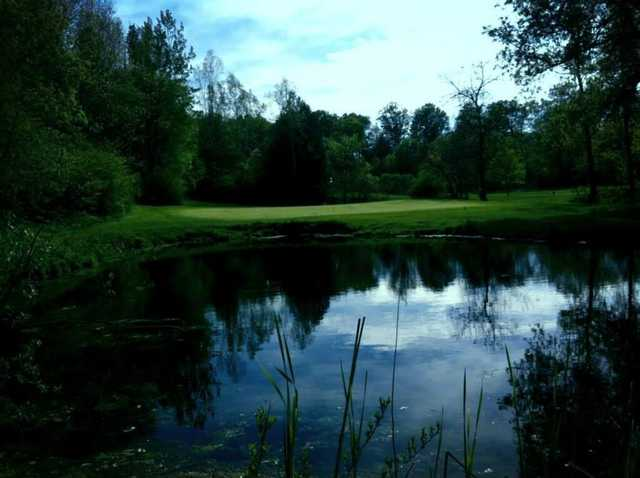 A view over the water of the 17th green at Valley from Remington Parkview Golf and Country Club