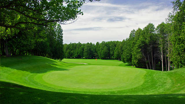 A sunny day view of a hole at Glen Cedars Golf Club
