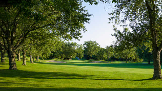 A view from the left side of a fairway at Glen Cedars Golf Club
