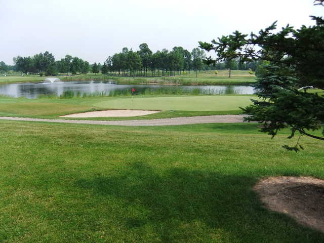 A view of hole #2 with water and bunkers coming into play at Deerfield Golf Course