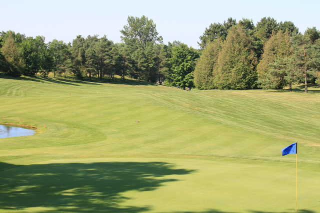 A view of a hole and a fairway at Sleepy Hollow Country Club