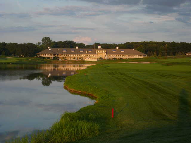 Eagle Eye Golf Club's giant clubhouse serves as the backdrop on No. 9