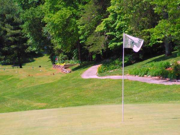 A view of a hole with an undulating cart path in background at White Plains Golf Course