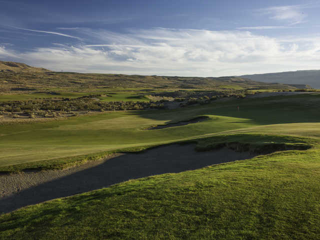 A view of the 16th green protected by bunkers at Gamble Sands Golf Club