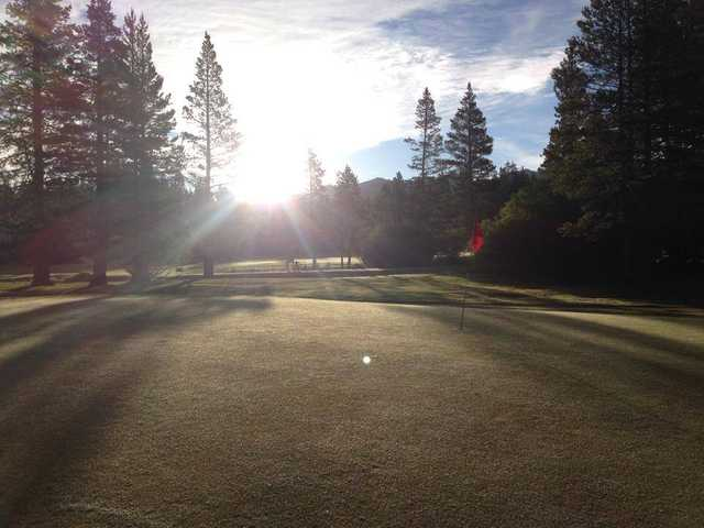 A sunny day view of a hole at Tahoe Paradise Golf Course