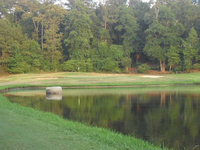 A view of a green with bunkers and water coming into play at Landings Golf Club