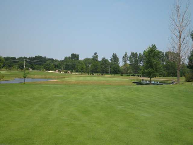 A view of a green surrounded by water at Gold Course from Green Garden Country Club