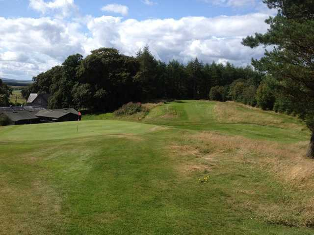 A view of a green and a fairway at Hawick Golf Club