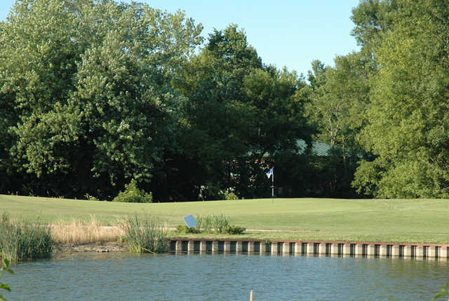 A view over the water of hole #10 at River Heights Golf Course