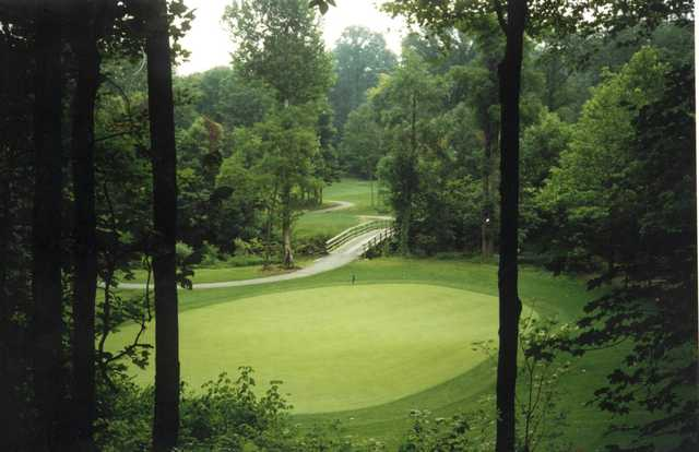 A view of a green with a bridge in background at Old Oakland Golf Club