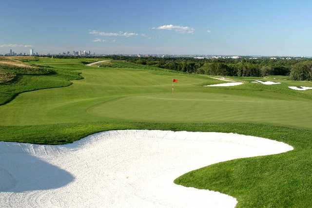 A view of a hole protected by sand traps at Granite Links Golf Club from Quarry Hills