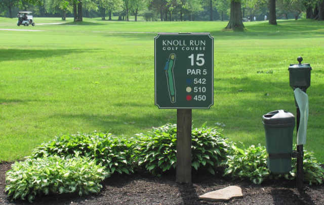 A view from the 15th tee sign at Knoll Run Golf Course