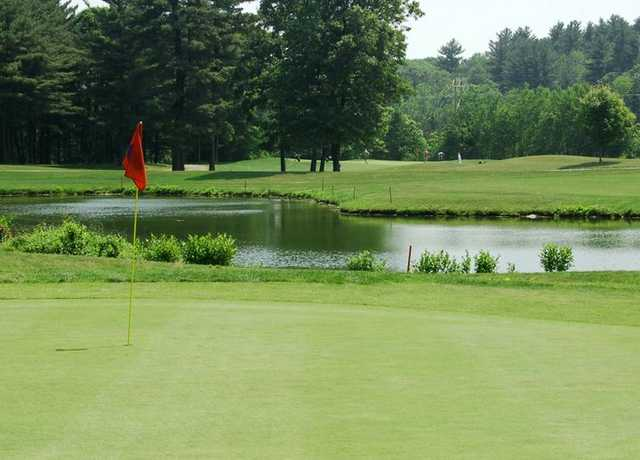 A view of a hole with water in background at Sassamon Trace Golf Course