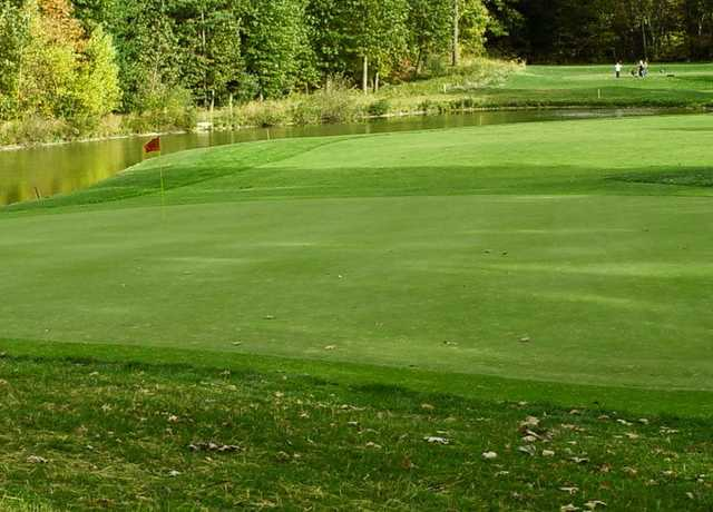 A view of a green with water coming into play at Sassamon Trace Golf Course