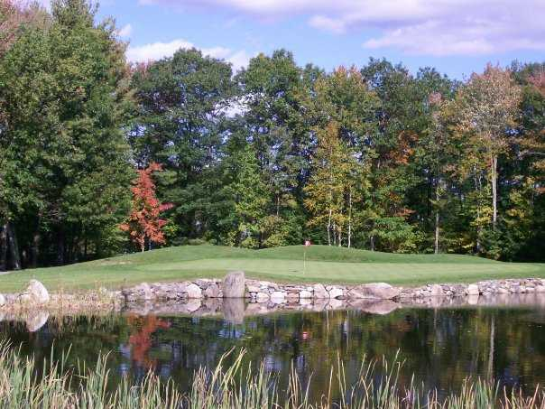 A view of a green with water coming into play at Windham Country Club
