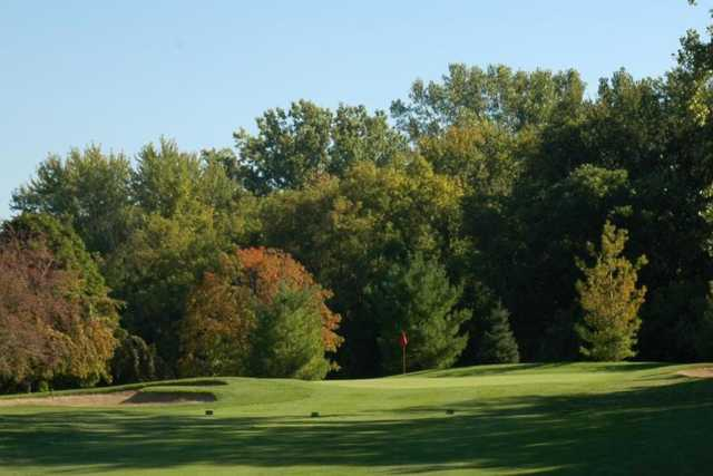 A view of a green protected by bunkers at Hilltop Golf Course
