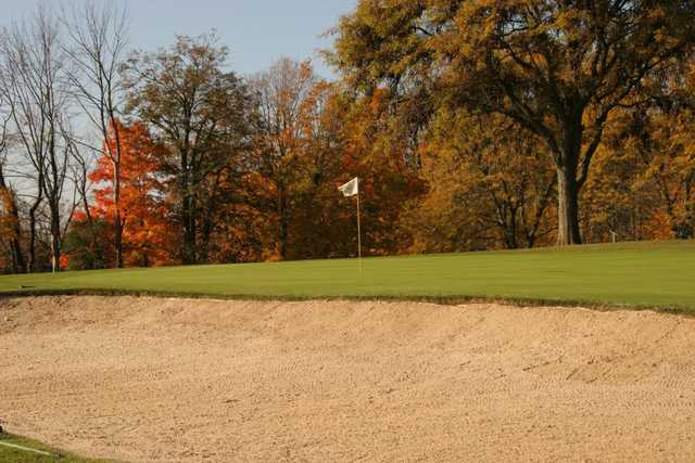 A view of a holeguarded by a bunker at Salem Hills Golf Club