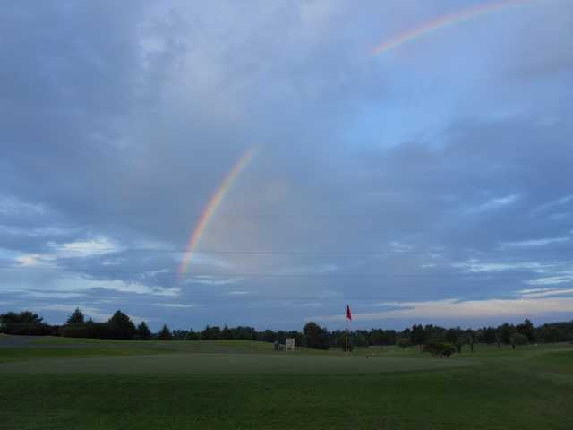 A view of a rainbow over hole #18 at Calvert City Golf & Country Club
