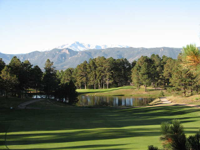The Country Club at Woodmoor: View of the 13th hole with Pikes Peak serving as backdrop