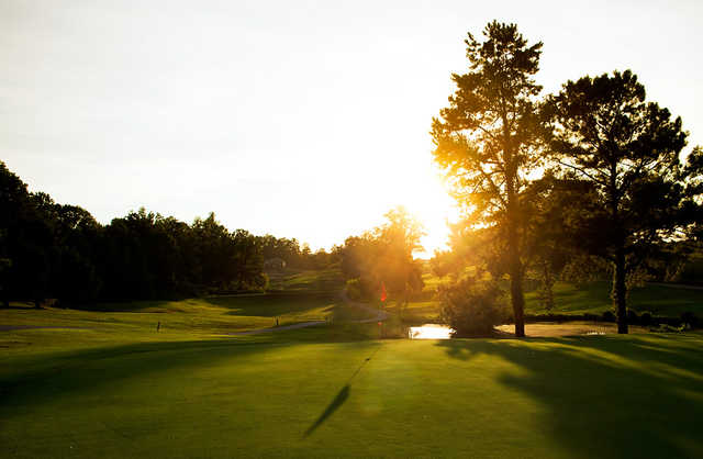 A sunny day view of a green at Southwick Country Club (McKnight Media)