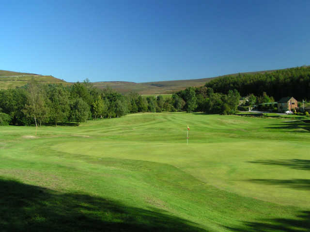 A sunny day view of a green at Glossop & District Golf Club