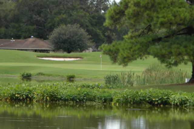 A view over the water of hole #4 Oakwing Golf Club.