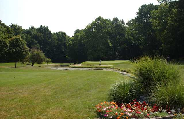 A view of a green surrounded by water from Meadowbrook at Clayton