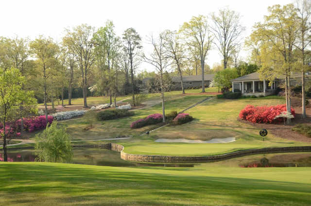 A view of a green surrounded by water at Chanticleer from Greenville Country Club