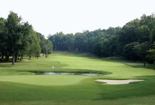 A view of a green with water coming into play at Green Valley Country Club