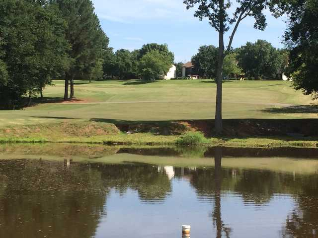 A view over the water of fairway #5 at Holly Tree Country Club