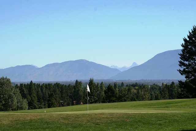 A view of a hole with mountains in background at Buffalo Hill Golf Club